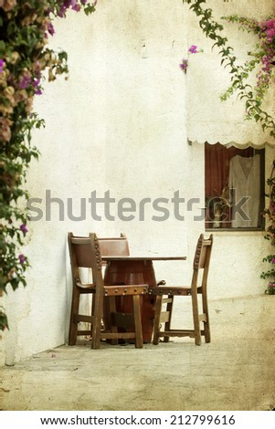 Vintage photo of rustic terrace on a mediterranean island - stock photo