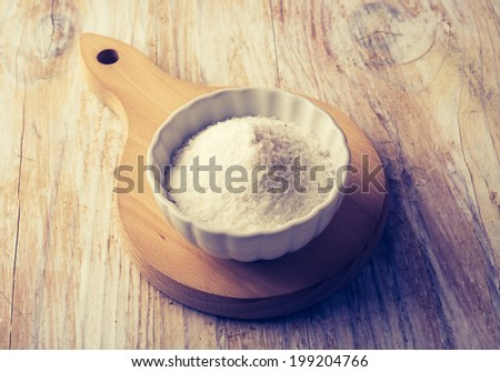 vintage photo of salt in a bowl  - stock photo