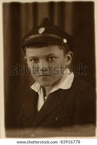 Vintage photo of schoolboy in uniform (twenties) - stock photo