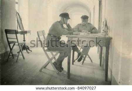 Vintage photo of soldiers learning (thirties) - stock photo