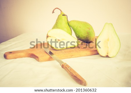 vintage photo of still life with pears - stock photo