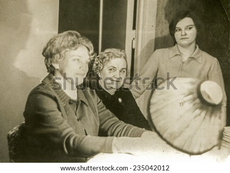 Vintage photo of three generations of family - grandmother, mother and daughter, sixties - stock photo