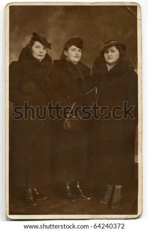 Vintage photo of three sisters - stock photo