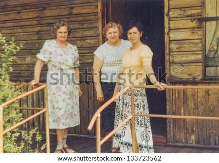 Vintage photo of three woman on terrace (seventies) - stock photo