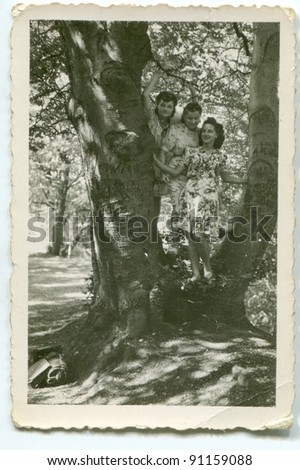 Vintage photo of three young women outdoor (forties) - stock photo