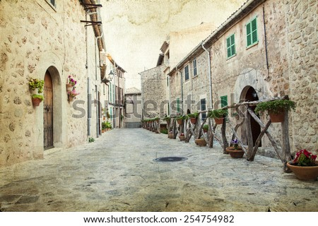 Vintage photo of traditional houses in mediterranean village in Mallorca, Spain - stock photo