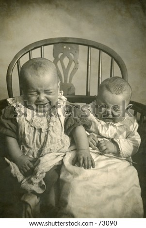 Vintage photo of two babies crying, circa 1900 - stock photo