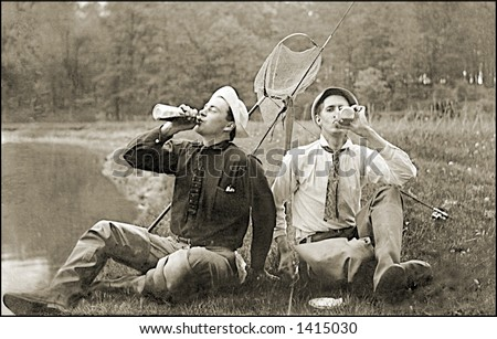 Vintage photo of Two Fishermen On Shore Drinking - stock photo