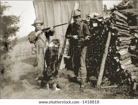 Vintage photo of Two Men With Guns By Woodpile - stock photo