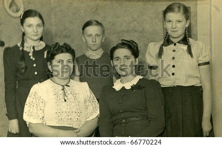 Vintage photo of two sisters with their children - stock photo