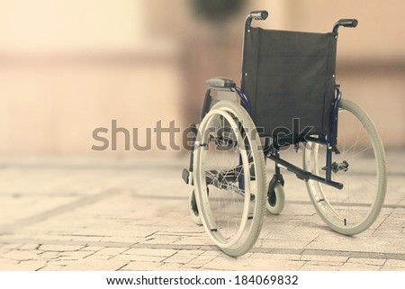vintage photo of wheelchair and street with sunlight  - stock photo
