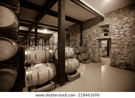 Vintage photo of  winery  with many barrels  - stock photo