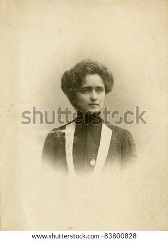 Vintage photo of woman circa 1910 - stock photo