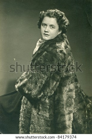 Vintage photo of woman in fur coat (1959) - stock photo