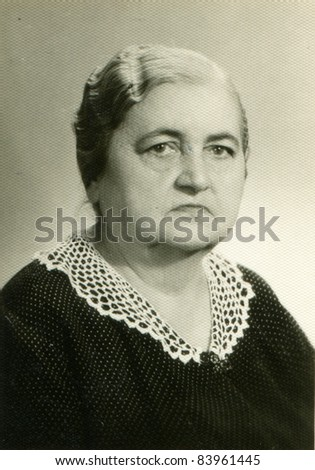 Vintage photo of  woman (sixties) - stock photo