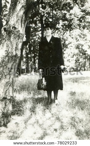 Vintage photo of woman (thirties/forties) - stock photo