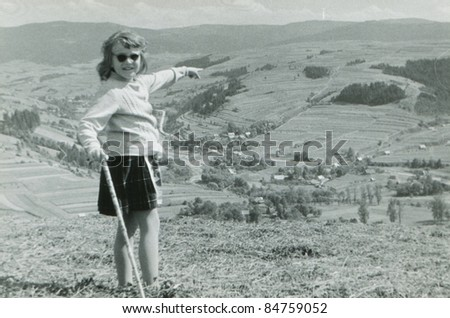 Vintage photo of young girl trekking in mountains (fifties) - stock photo