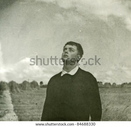 Vintage photo of young man (sixties) - stock photo