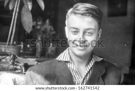 Vintage photo of young smiling boy, sixties - stock photo