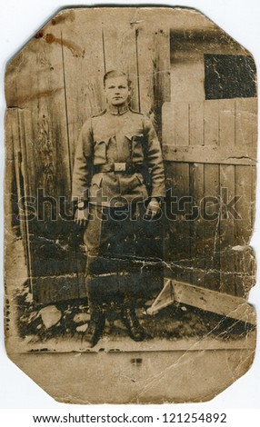 Vintage photo of young soldier (circa 1915) - stock photo