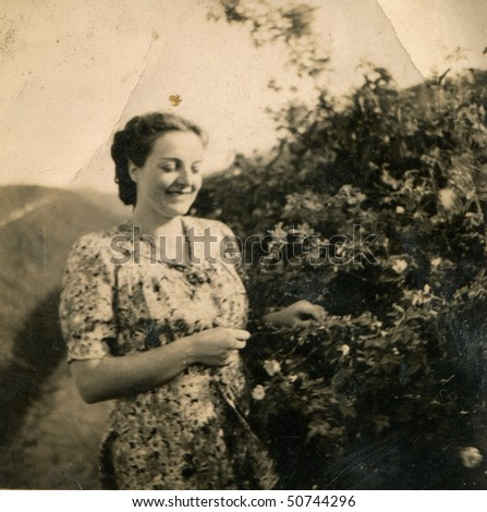 Vintage photo of young woman (1944) - stock photo