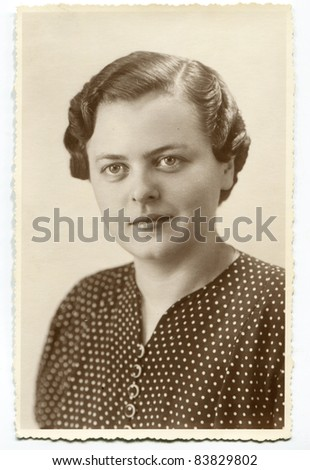 Vintage photo of young woman (forties) - stock photo
