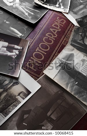 vintage photographs on an old photo album