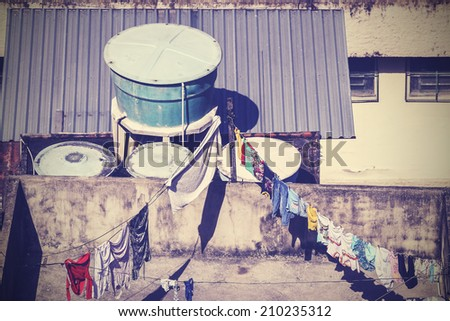 Vintage picture of clothes drying on rooftop, Rio de Janeiro, Brazil. - stock photo