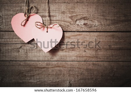 vintage pink hearts on wooden background - stock photo