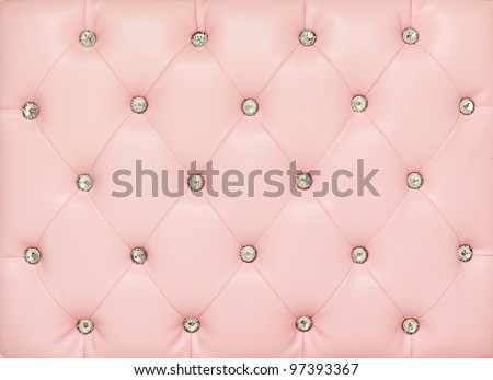 Vintage pink leather background with crystal button - stock photo