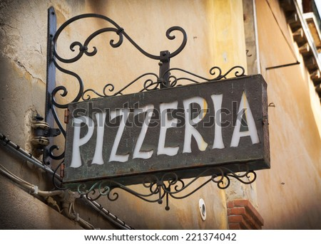 Vintage pizzeria sign in Venice Italy - stock photo