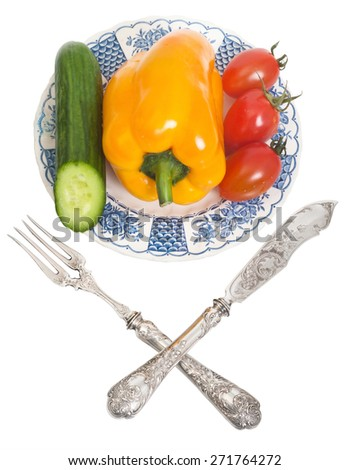 vintage plate with pepper, tomatoes and cucumber - stock photo