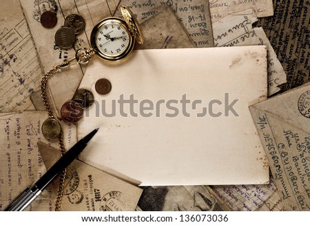 vintage pocket clock, pen and money on old letters texture - stock photo