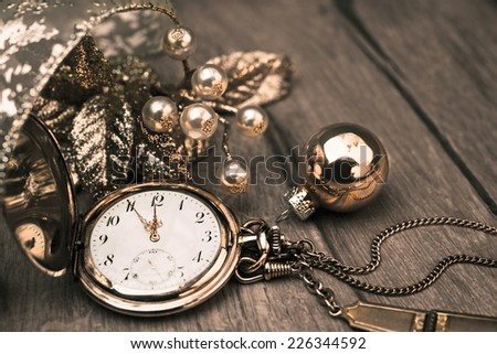 Vintage pocket clock showing five to twelve. Happy New Year 2015! - stock photo