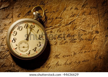 Vintage pocket-watch and old hand-written personal letter - stock photo
