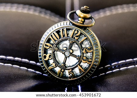 Vintage pocket watch on leather,Time concept - stock photo