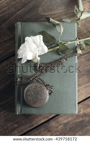 Vintage pocket watch on old books. From above - stock photo