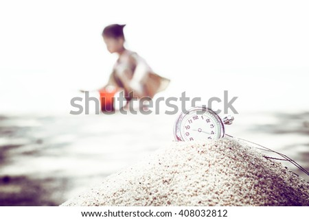 vintage pocket watch on sand.