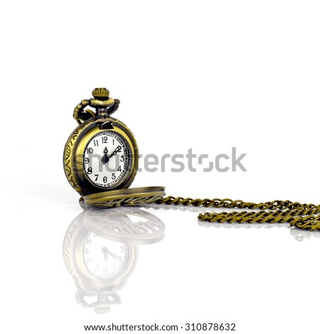 Vintage pocket watch on white background with reflection.
