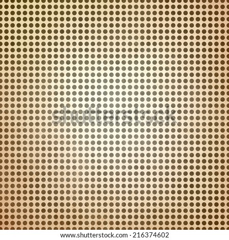vintage polka dotted brown background, brown spots on beige paper with faint white center spot lighting - stock photo