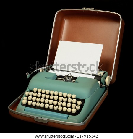 vintage portable typewriter with 1960s colors in carrying case; isolated on black - stock photo