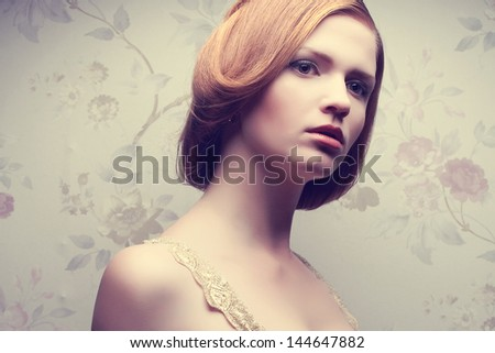 Vintage portrait of a glamorous doll-like retro girl. Healthy ginger (red) hair. Perfect skin. Hollywood style (film noir). Close up. Copy-space. Studio shot - stock photo