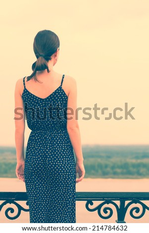 Vintage portrait of a young woman outdoors - stock photo