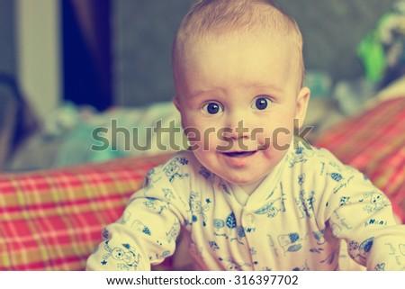 Vintage portrait of adorable smiling baby boy - stock photo