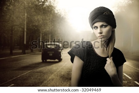 vintage portrait of beautiful woman on London street - stock photo