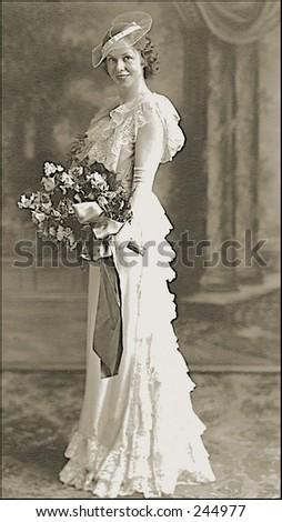 Vintage Portrait Of Bride With Bouquet - stock photo