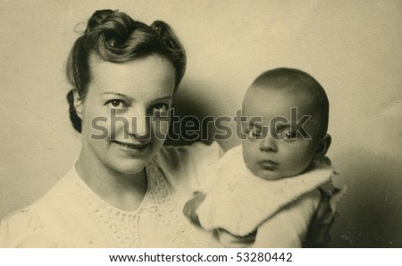 Vintage portrait of mother with her baby (forties) - stock photo