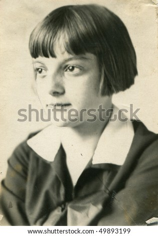 Vintage portrait of young girl with original retouching (circa 1924) - stock photo