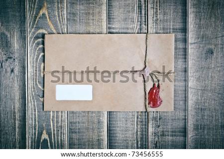 Vintage postal envelope on wood texture - stock photo