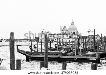 Vintage postcard of Venice, Italy. Panorama view of The Grand Canal with gondola and Santa Maria della Salute church. Monochrome beautiful background of the venetian canal. Black and white photo. - stock photo